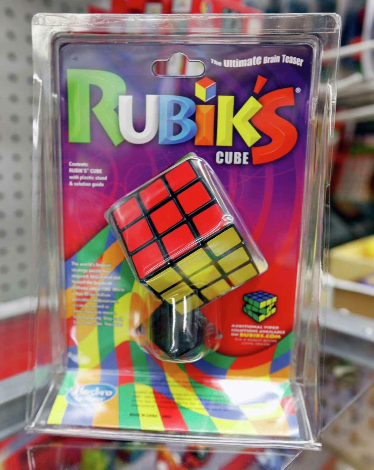 2) How to solve a Rubik's cube: Please teach us.