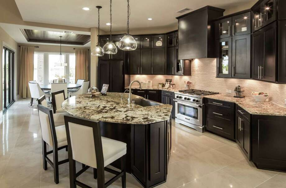 Ashton Woods Homes has introduced its largest series of homes into a third Houston-area development, Cypress Creek Lakes. Photo: Courtesy Photo / ©2013 Steve Chenn Photography
