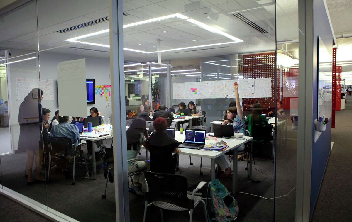 Students attend a Girls Who Code class for young women at Square headquarters in San Francisco in July. Attendance at next month's Grace Hopper Celebration is soaring as tech firms seek more female employees.