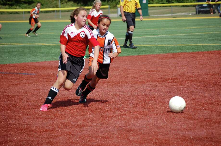 New Canaan's Courtney O'Connell competes in a New Canaan U12 girls Red team game on Saturday, Sept. 20 against Watertown. Photo: Contributed / New Canaan News Contributed