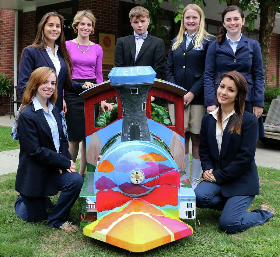 Glenholme School students, from left to right, front, Hannah Leach and Samara Karow, and, back, Samantha Heerman, Glenholme art teacher Claire Milnamow, Adam Godfrey, Courtney Hynes and Diane DeJonghe pose recently with their artistic creation in front of Martyís Café in Washington Depot. September 2014  Courtesy of Devereux Glenholme School Photo: Contributed Photo / The News-Times Contributed