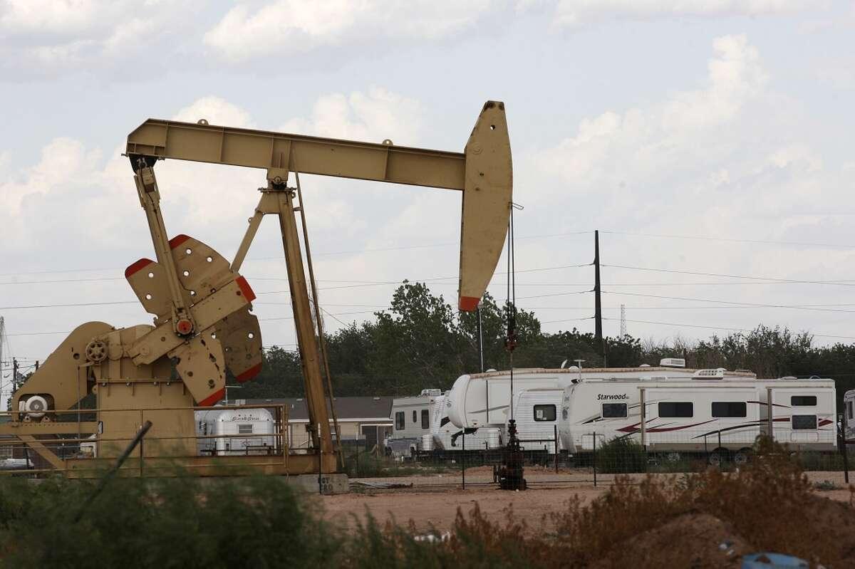 An RV park is located near a pump jack in Midland, Texas.