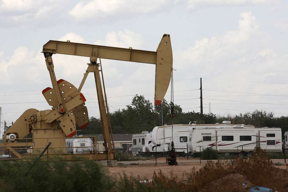 An RV park is located near a pump jack in Midland, Texas, Wednesday, July 25, 2012. The oil and gas boom in the Permian Basin has driven up demand for housing and services. Photo: San Antonio Express-News
