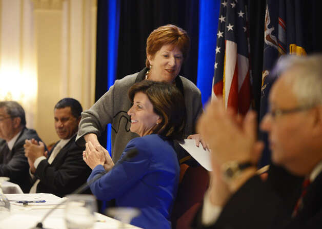 Albany Mayor Kathy Sheehan is congratulated by Kathy Hochul, Gov. Andrew Cuomo's running mate, following Mayor Sheehan's speech to the state Democratic Committee Monday, Sept. 22, 2014, during a party meeting at the Desmond Hotel in Colonie, N.Y. (Will Waldron/Times Union) Photo: WW, Albany Times Union / 00028714A