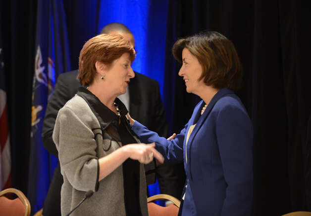 Albany Mayor Kathy Sheehan, left, chats with Kathy Hochul, Gov. Andrew Cuomo's running mate, right, during the state Democratic Committee meeting Monday  Sept. 22, 2014, at the Desmond Hotel in Colonie, N.Y. (Will Waldron/Times Union) Photo: WW, Albany Times Union / 00028714A