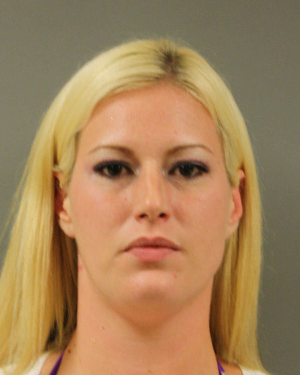 Elizabeth Evans has been arrested as part of an undercover operation by Harris County Sheriff's Department at a northwest Harris County strip club.
