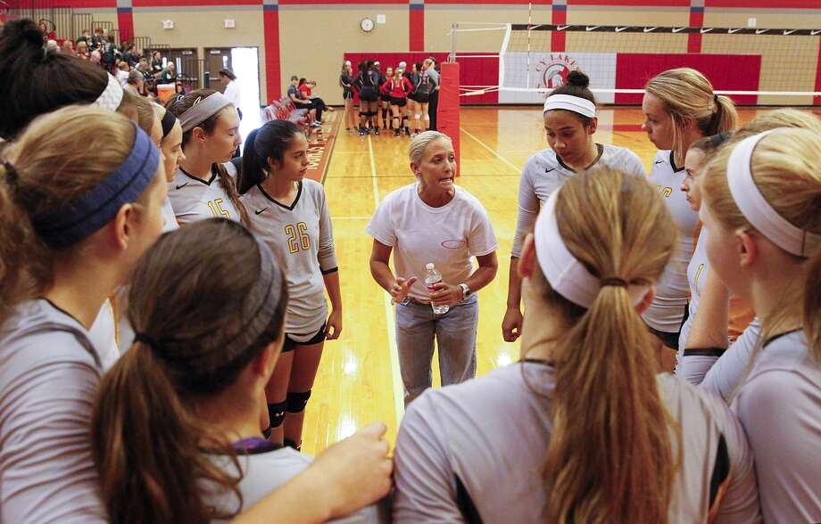 Klein Oak head volleyball coach Christie Mewis gave the team some instructions during a time out as they took on Cy Lakes earlier this season. Photo: Diana L. Porter, Freelance / © Diana L. Porter