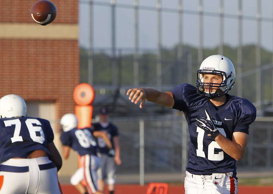 Seven Lakes' quarterback prospect Tristan Hibbler on the Blue team fires off a pass during the Seven Lakes Spring Game at Seven Lakes High School on May 22, 2014. Photo: Diana L. Porter, Freelance / © Diana L. Porter