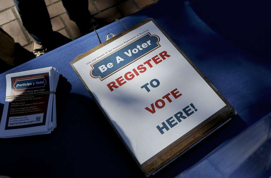A display is set up in United Nations Plaza urging people to register to vote, as seen on Tuesday Sept. 23, 2014, in San Francisco, Calif. The San Francisco Department of Elections holds a voter registration drive at UN Plaza during today's National Voter Registration Day. Photo: Michael Macor, The Chronicle