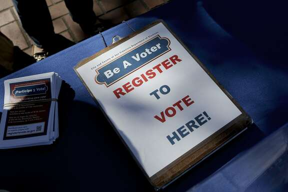 A display is set up in United Nations Plaza urging people to register to vote, as seen on Tuesday Sept. 23, 2014, in San Francisco, Calif. The San Francisco Department of Elections holds a voter registration drive at UN Plaza during today's National Voter Registration Day.
