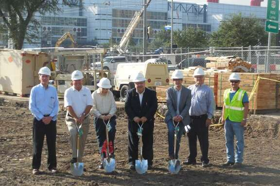Officials attend a groundbreaking this month for the dual-branded Hampton Inn and Homewood Suites Hotel along Crawford Street downtown.