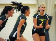 Greenwich Academy's Ellen Clark, left, Jessica Lui, center, and Olivia Hartwell celebrate in Greenwich Academy's 3-1 win over Masters School in the high school girls volleyball game at Greenwich Academy in Greenwich, Conn. Tuesday, Sept. 23, 2014.