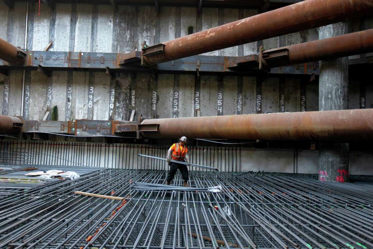 Julio Alvarran straddles rebar 65-feet below the surface as construction work continues on the Transbay Transit Center in San Francisco.