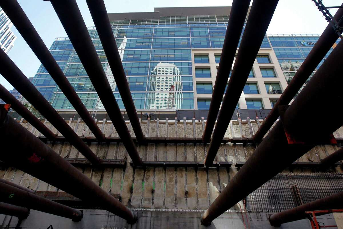 Construction continues on the Transbay Transit Center in San Francisco, even as a legal fight brews over how much in taxes developers should pay on their projects near the facility.