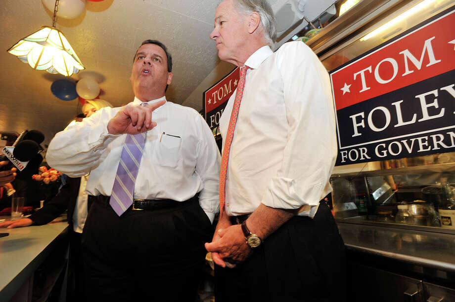 New Jersey Gov. Chris Christie, left, answers questions from the media while stumping for Connecticut gubernatorial candidate Tom Foley, right, at Curley's Diner in Stamford, Conn., on Tuesday, Sept. 23, 2014. Photo: Jason Rearick / Stamford Advocate