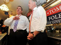 New Jersey Gov. Chris Christie, left, answers questions from the media while stumping for Connecticut gubernatorial candidate Tom Foley, right, at Curley's Diner in Stamford, Conn., on Tuesday, Sept. 23, 2014.