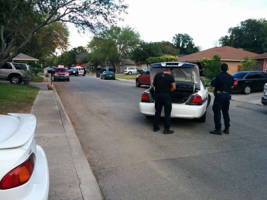 San Antonio Police officers respond to a shooting call in the 9700 block of Hidden Plains Street on the city's Northwest  Side on Tuesday, Sept. 23, 2014. Photo: Jacob Beltran/San Antonio Express-News