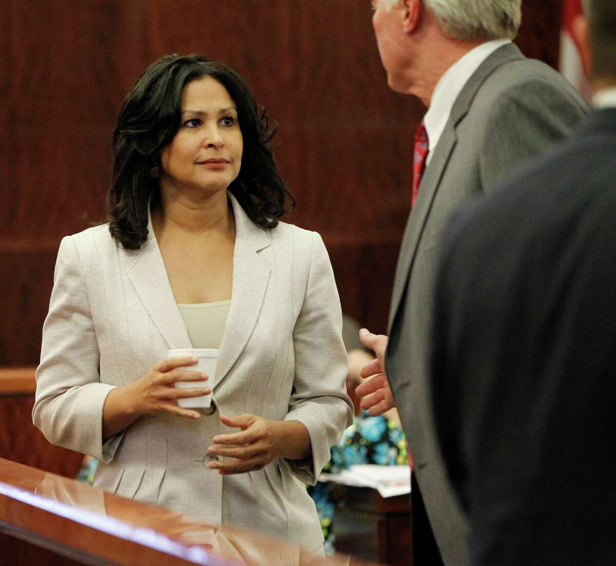 Evette Toney, the girlfriend of Dr. George Blumenschein, speaks with an attorney after her testimony during the trial of Dr. Ana Maria Gonzalez-Angulo, the cancer doctor accused of poisoning the coffee of a lover, in the 248th State District Court, Monday, Sept. 22, 2014, in Houston. ( Karen Warren / Houston Chronicle )