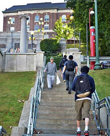 Students and pedestrians make their way along the  concrete steps going up to the finished Approach at Rensselaer Polytechnic Institute Tuesday, Sept. 22, 2014, in Troy, N.Y.  (John Carl D'Annibale / Times Union) Photo: John Carl D'Annibale / 00028724A