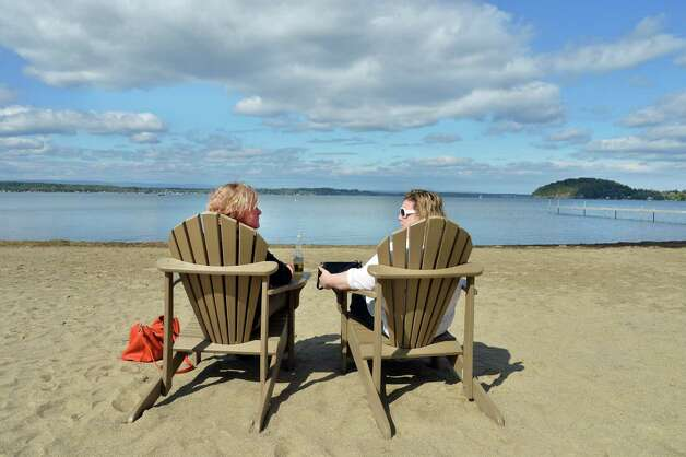 Johna Rossi, left, of Mechanicville and Stephanie Connelly of Stillwater enjoy a perfect Saratoga Lake vista at Brown's Beach Tuesday, Sept. 23, 2014, in Stillwater, N.Y.  (John Carl D'Annibale / Times Union) Photo: John Carl D'Annibale