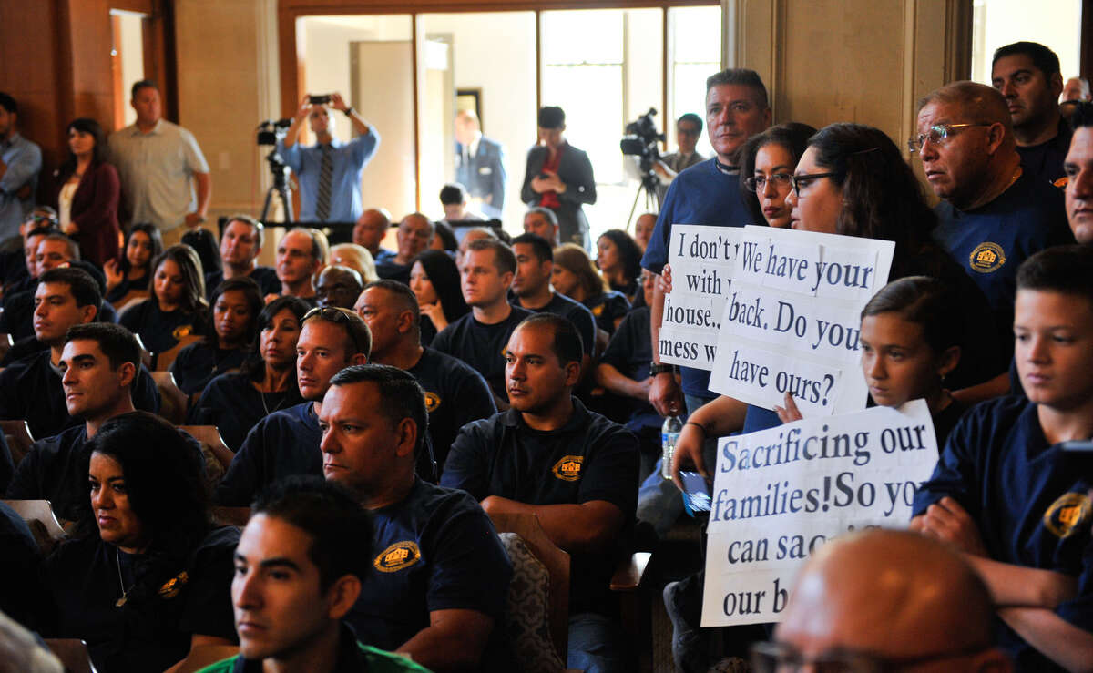 Members of the police and firefighters unions filled the City Council chamber during last Thursday's meeting, when a $2.4 billion budget for fiscal year 2015 was approved.