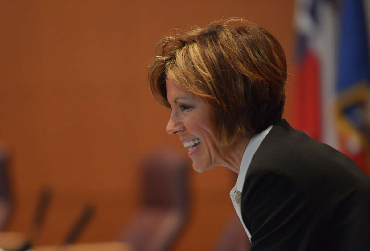 San Antonio City Manager Sheryl Sculley laughs prior to Thursday's city council meeting to approve the FY2015 budget.