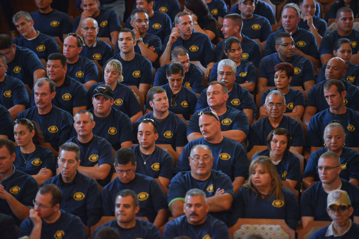 Members of the police and firefighters unions fill the Norma Rodriguez City Council Chamber's during Thursday's council meeting to approve the FY2015 budget.