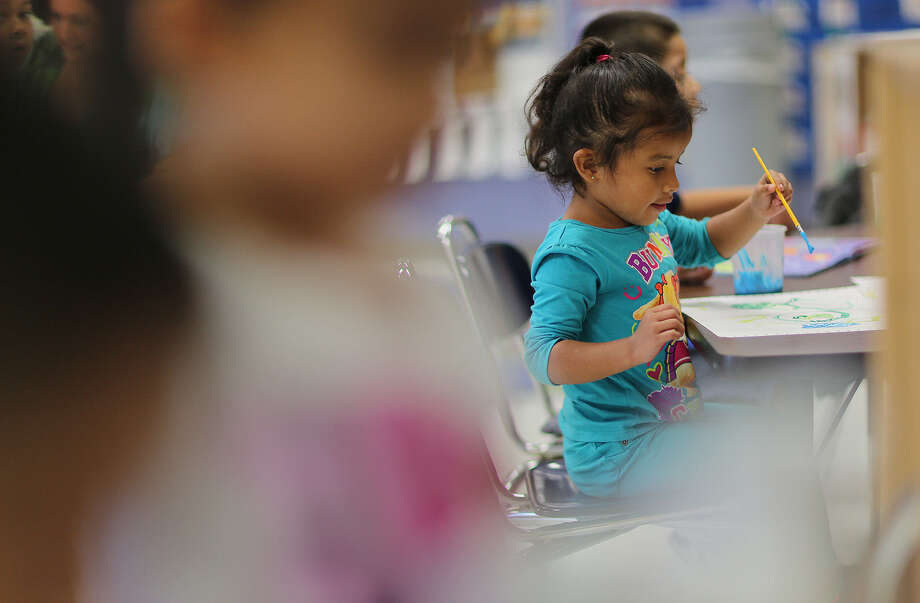 Mikyla Alvarado, 4, draws shapes Tuesday in her pre-kindergarten class at Collier Elementary School in the Harlandale Independent School District. The district is among several that use their own funds to subsidize their preschool program. Photo: Photos By Jerry Lara / San Antonio Express-News / © 2014 San Antonio Express-News