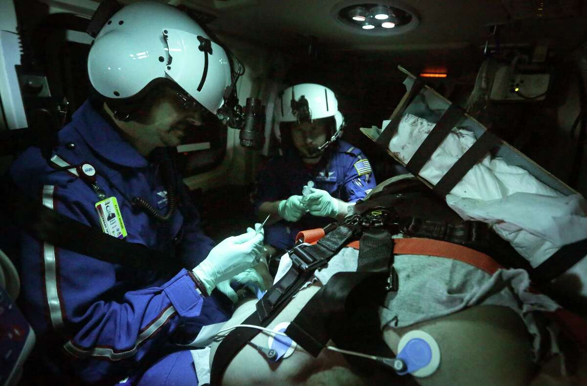 Air Life flight nurse Shawn Russell (left) and flight medic Mike Boulding tend to a patient headed from Nixon to San Antonio in February. At the time, Air Life had been seeing a rise in calls involving trauma victims in the Eagle Ford Shale.
