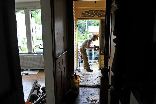 Dan Pardee, parts warehouse manager for Historic Albany Foundation, removes door hinges during a salvage operation at a home at 148 Morris St. on Tuesday, Sept. 16, 2014, in Albany, N.Y.     (Paul Buckowski / Times Union) Photo: Paul Buckowski / 00028128A