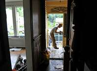 Dan Pardee, parts warehouse manager for Historic Albany Foundation, removes door hinges during a salvage operation at a home at 148 Morris St. on Tuesday, Sept. 16, 2014, in Albany, N.Y.     (Paul Buckowski / Times Union)