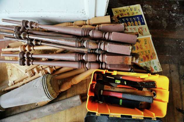 The tools used by workers with Historic Albany Foundation are seen next to stair balusters that are being salvaged from a home on Morris St. on Tuesday, Sept. 16, 2014, in Albany, N.Y.     (Paul Buckowski / Times Union) Photo: Paul Buckowski / 00028128A
