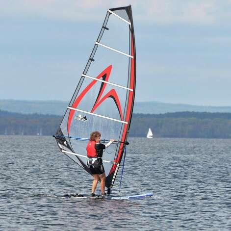 Adirondack Board Sailing Club member Adena Korusek of Saratoga Springs windsurfs on Saratoga Lake near Brown's Beach Tuesday, Sept. 23, 2014, in Stillwater, N.Y.  (John Carl D'Annibale / Times Union) Photo: John Carl D'Annibale