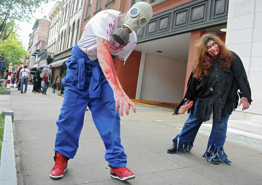 Zombies from the Double M haunted hayride roam around Broadway on Tuesday, Sept. 23, 2014 in Saratoga Springs, N.Y. (Lori Van Buren / Times Union)