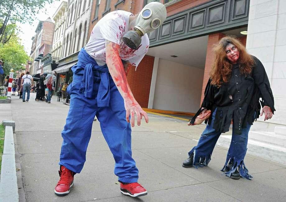 Zombies from the Double M haunted hayride roam around Broadway on Tuesday, Sept. 23, 2014 in Saratoga Springs, N.Y. (Lori Van Buren / Times Union) Photo: Lori Van Buren