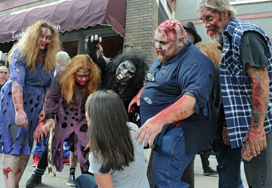 Zombies from the Double M haunted hayride scare Jennifer Schaffino of El Paso, TX as they roam around Broadway on Tuesday, Sept. 23, 2014 in Saratoga Springs, N.Y. (Lori Van Buren / Times Union) Photo: Lori Van Buren