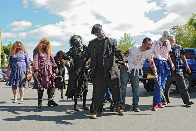Zombies from the Double M haunted hayride take over the streets on Tuesday, Sept. 23, 2014 in Saratoga Springs, N.Y. (Lori Van Buren / Times Union) Photo: Lori Van Buren