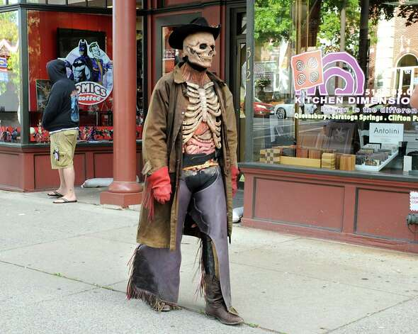 Zombie Scary Harry walks down a sidewalk along Broadway after the Double M held a press conference on Monday, Sept. 22, 2014 in Saratoga Springs, N.Y. The Double M which holds haunted hayrides announced that on Tuesday, September 23rd at 2pm their zombies will arrive in Downtown Saratoga for #zombietoga where they will roam for approximately 1-2 hours. (Lori Van Buren / Times Union) Photo: Lori Van Buren / 00028703A