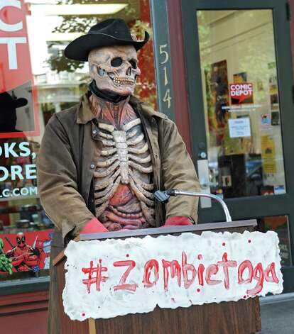 Zombie Scary Harry stands in front of Comic Depot as the  Double M holds a press conference on Monday, Sept. 22, 2014 in Saratoga Springs, N.Y. The Double M which holds haunted hayrides announced that on Tuesday, September 23rd at 2pm their zombies will arrive in Downtown Saratoga for #zombietoga where they will roam for approximately 1-2 hours. (Lori Van Buren / Times Union) Photo: Lori Van Buren / 00028703A