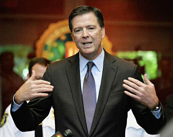 FBI Director James B. Comey, the presidentially appointed seventh Director of the FBI, speaks during a news conference Tuesday Sept. 23, 2014, in Albany, NY.  (John Carl D'Annibale / Times Union) Photo: John Carl D'Annibale / 00028720A