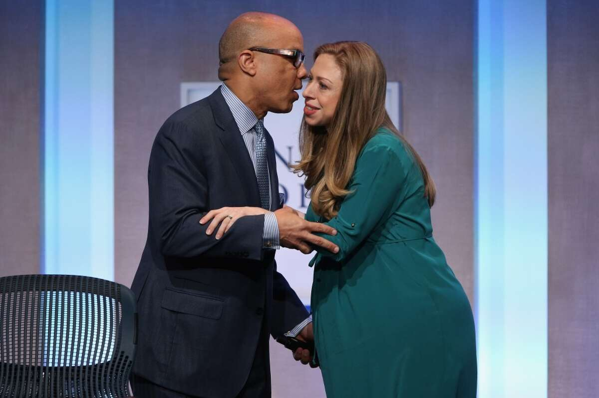 NEW YORK, NY - SEPTEMBER 23: Ford Foundation President Darren Walker and Chelsea Clinton, Vice Chair of the Clinton Foundation, embrace before a panel discussion at the Clinton Global Initiative (CGI), on September 23, 2014 in New York City. The annual meeting, established in 2005 by President Clinton, convenes global leaders to discuss solutions to world problems.