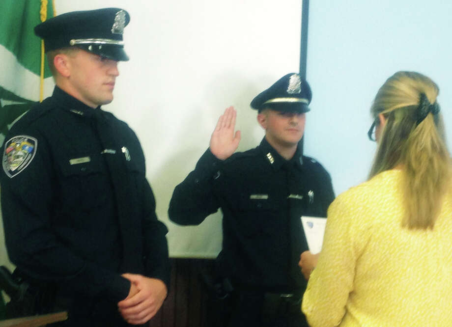 Christopher Hayes,  left, in his 2014 swearing-in ceremony for the New Milford Police Department. A new report by the state's attorney says the shooting of an armed New Milford man by Hayes in August 2017 was justified. Photo: Susan Tuz / The News-Times