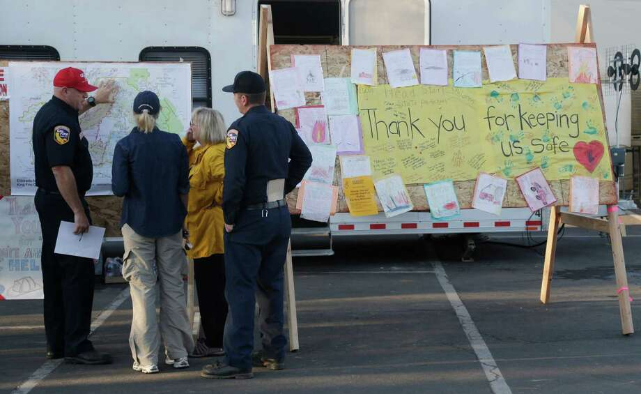 A sign thanks firefighters for their efforts in fighting the King Fire on Tuesday, Sept. 23, 2014, in Placerville, Calif. Nearly 2,000 firefighters were added Tuesday to battle the massive Northern California wildfire threatening thousands of homes in anticipation of erratic winds and hotter temperatures that could undo their progress. Photo: Marcio Jose Sanchez, AP / AP
