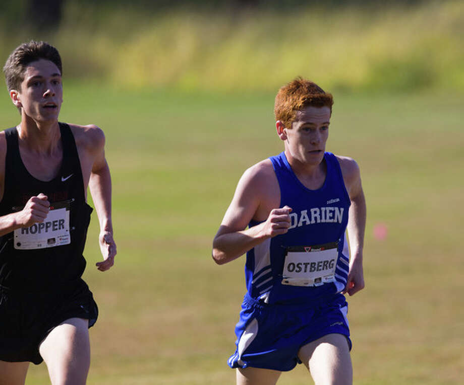 Darien's Alex Ostberg competes against former Ridgefield runner Trevor Hopper in the 2013 FCIAC cross country championships at Waveny Park in New Canaan. Photo: Contributed / Darien News Contributed
