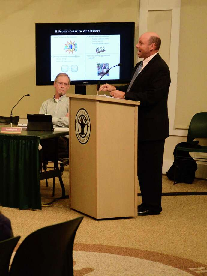Jeffrey Ziplow, a partner with Blum Shapiro and consultant for the Town of New Canaan, Conn., speaks about Munis, a financial accounting system that will replace the current one used by the town, during a Town Council meeting Wednesday, Sept. 17, 2014, at the New Canaan Nature Center. Pictured on the left, Councilman Sven Englund. Photo: Nelson Oliveira / New Canaan News