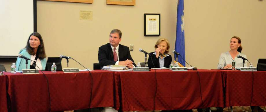 From left, Board of Education member Alison Bedula, Interim Superintendent of Schools Bryan Luizzi, board chairman Hazel Hobbs and board member Dionna Carlson during a meeting at New Canaan High School, New Canaan, Conn., Monday, Sept. 22, 2014. Photo: Nelson Oliveira / New Canaan News