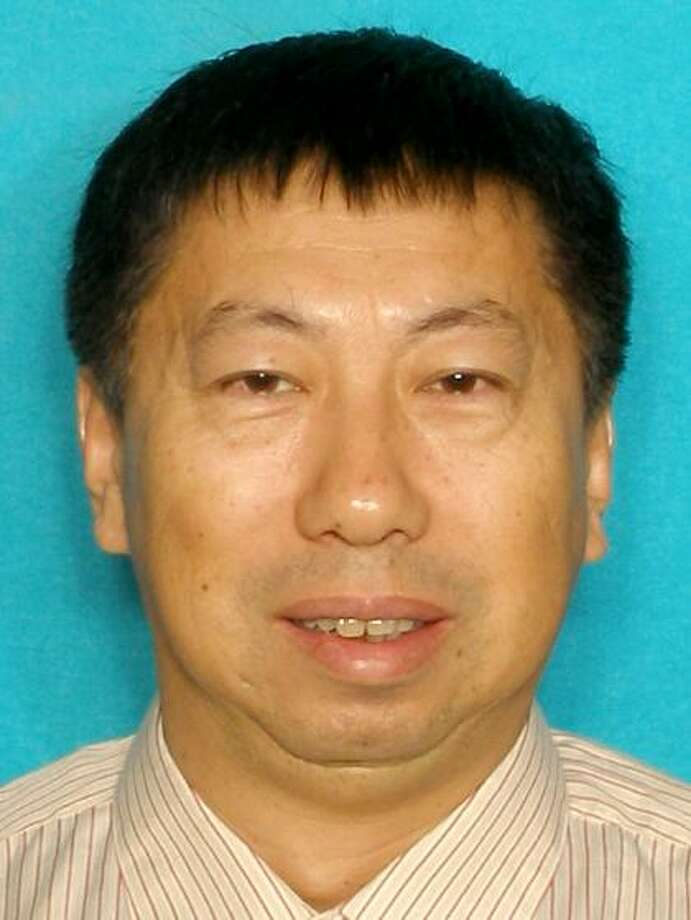 The Harris County Sheriff's Department has listed  Peide Yang, 53, as a suspect in the Sept. 24, 2014 deaths of his wife  Zhi Liu, 55, and step-so. Bang An, 22. Photo: Harris County Sheriff's Office