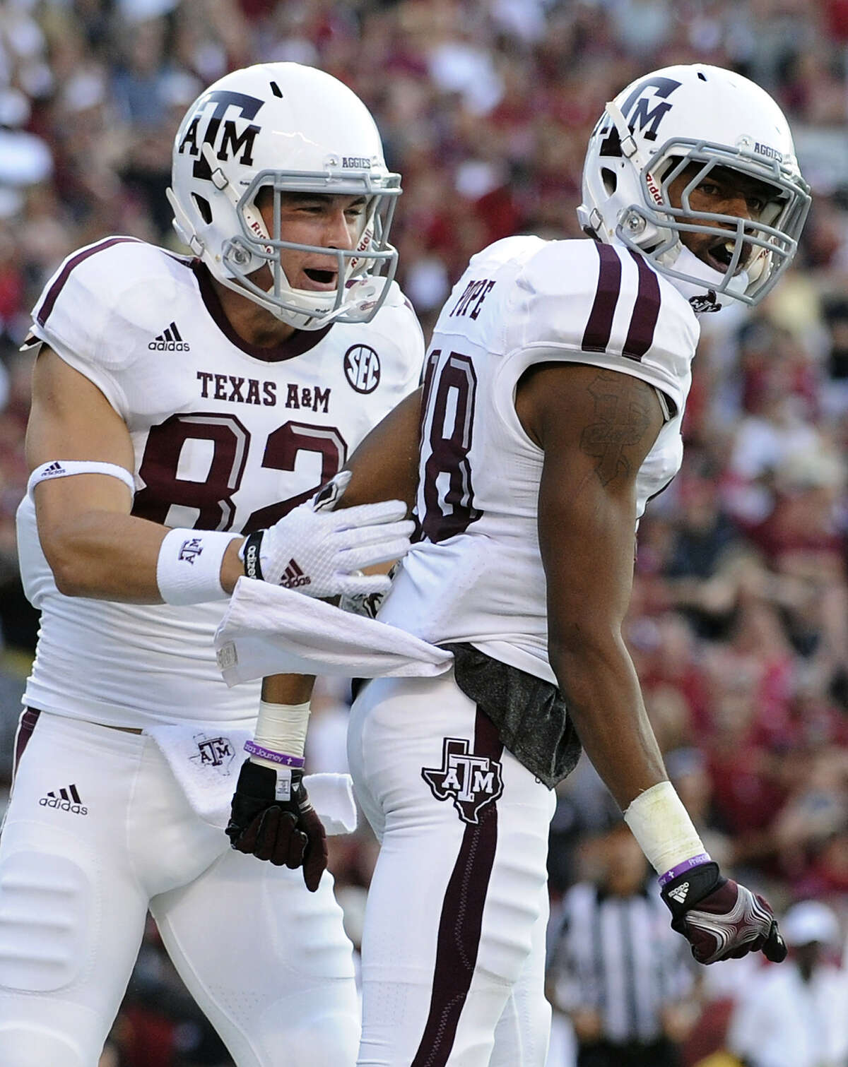 Texas A&M wide receiver Edward Pope (18) celebrates with teammate Boone Niederhofer (82) after scoring a touchdown against South Carolina during the first half of an NCAA college football game on Thursday, Aug. 28, 2014, in Columbia, South Carolina.