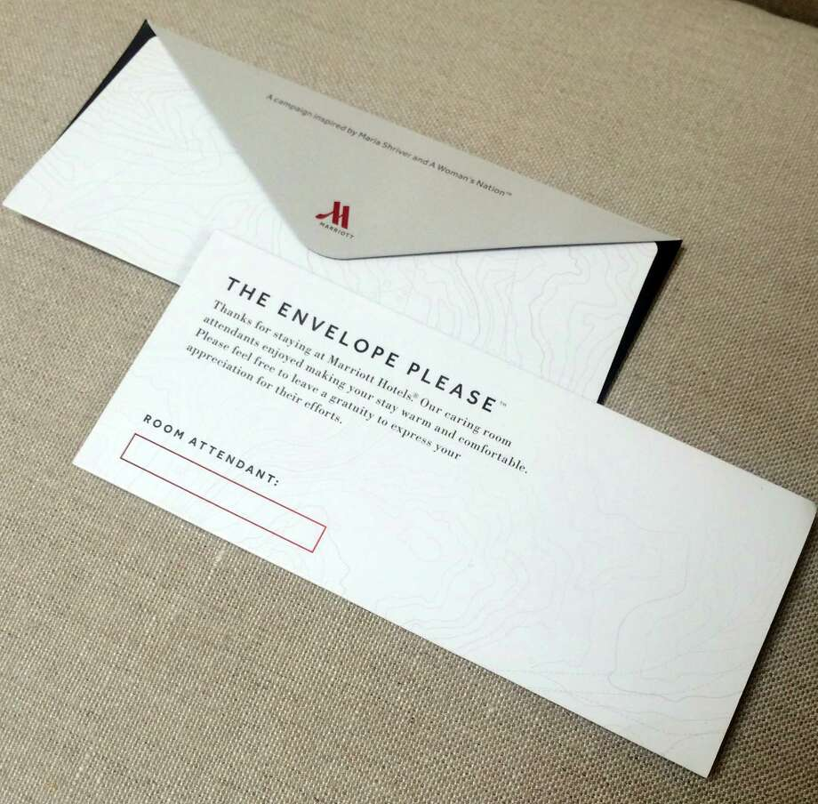 This photo provided by A Woman's Nation shows an envelope that Marriott will be placing in 160,000 hotel rooms in the U.S. and Canada beginning this week to encourage guests to leave a tip for the person who cleans the room. The envelopes bear the name of the room attendant. Marriott is launching the project with Maria Shriver, founder of A Woman's Nation, an organization that works on issues empowering women. Shriver says many travelers don't realize that it's customary to leave a tip for the person who cleans your hotel room. (AP Photo/A Woman's Nation) Photo: HONS / A Woman's Nation