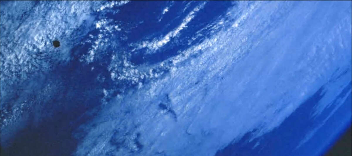 PROOF OF LIFE ON ANOTHER PLANET? Uh, porbably not. A large black disc apparently hovering over the ocean has been detected in a photo taken from the International Space Station. UFO Sightings Daily, a frequent source of analysis of photos from the Mars rovers, reported the news on Sept. 18.Can you see it?
